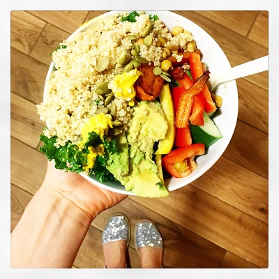 Buddha bowl with massaged kale and tahini dressing photo